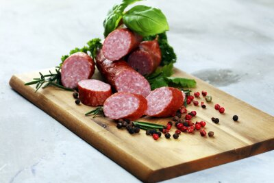 sausage slices, smoked meat product (tasty snack salami) menu concept. food background with cracow sausages