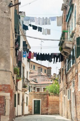 Fototapeta Scenery of hanging clothes in Venice, Italy.