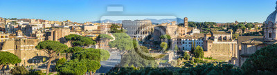Fototapeta Scenic panorama of Rome with Colosseum and Roman Forum, Italy.
