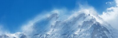 Fototapeta Scenic panoramic  mountain landscape  with snow-covered mountain range on the background of blue cloudy sky