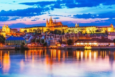 Fototapeta Scenic summer evening panorama of the Old Town architecture with Vltava river and St.Vitus Cathedral in Prague, Czech Republic
