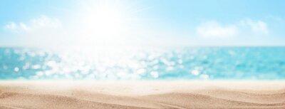 Fototapeta Sea beach with hot sand and sunny bokeh