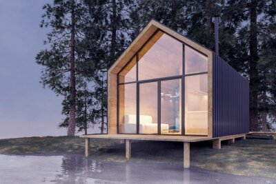 Fototapeta Secluded tiny house on the sandy shore of a lake with fog in a coniferous forest in cold cloudy lighting with warm light from the Windows. Stock 3D illustration