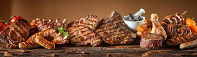 Fototapeta Selection of grilled gourmet meats on timber