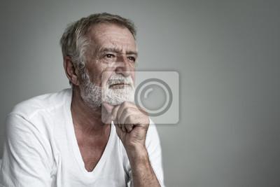 Fototapeta senior man thinking or try to remember alone closeup