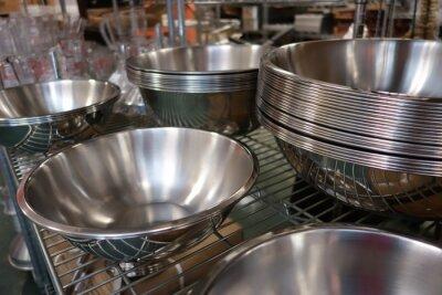 Fototapeta several stacks of empty stainless steel restaurant service bowls