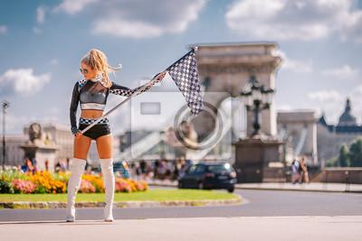 Fototapeta Sexy Grid Girl Hostess Woman Holding PoczĘ ... wszy Car Racing Flag w Budapeszcie