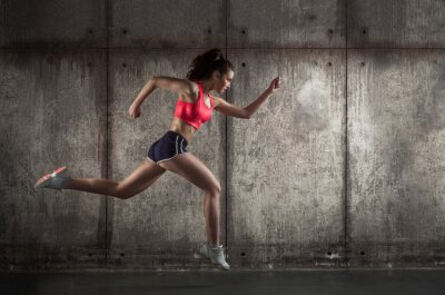 Fototapeta Side view of running woman