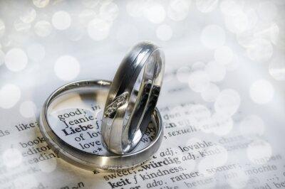 Fototapeta Silberne Eheringe rahmen das Wort