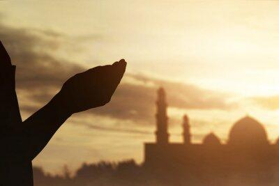 Fototapeta Silhouette of hands muslim man praying