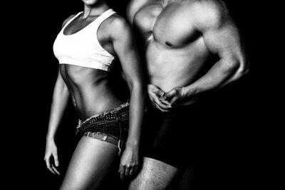 Fototapeta Silna kobieta i mężczyzna na czarnym tle