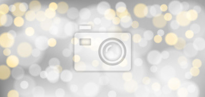 Fototapeta Silver bokeh background. Christmas glowing silver and golden lights with sparkles. Holiday decorative effect.