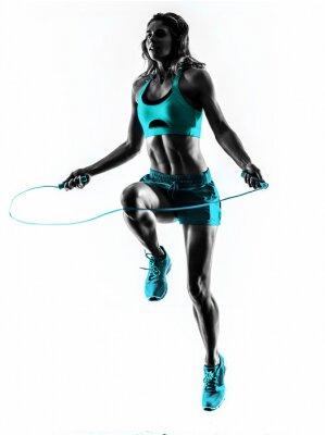 Fototapeta Skoki kobieta siłownia ćwiczenia linowe sylwetka