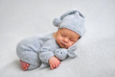 Fototapeta Sleeping newborn boy in the first days of life on white background