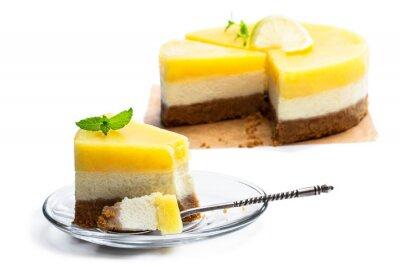 Fototapeta Slice of homemade lemon cheesecake isolated on white