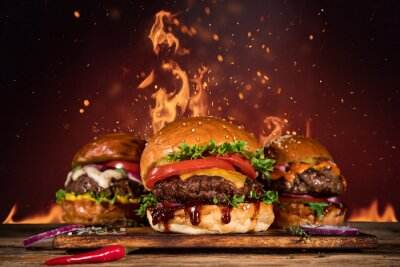Fototapeta Smaczny burger z frytkami i ogniem.