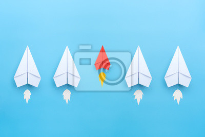 Fototapeta Small business concept with small red paper plane on blue background