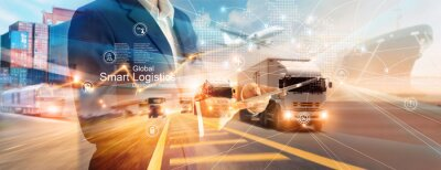 Fototapeta Smart logistics and transportation. Businessman use tablet and analyzing on logistic global network distribution on world map background. Technology. Business of transport and industrial.