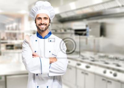Fototapeta Smiling kucharz w kuchni