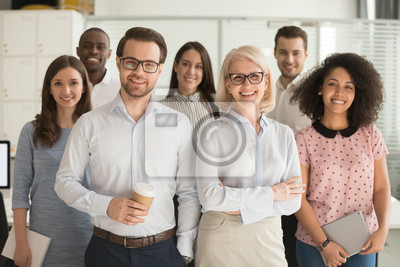 Fototapeta Smiling professional business leaders and employees group team portrait