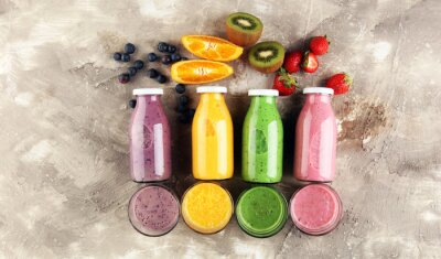 Smoothie variation. Healthy lifestyle concept. several bottles with fruit and berry juices smoothies or milkshakes
