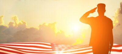 Fototapeta Soldier and USA flag on sunrise background .Concept National holidays , Flag Day, Veterans Day, Memorial Day, Independence Day, Patriot Day.