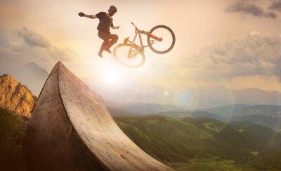 Fototapeta Sport. Motion biker jumps