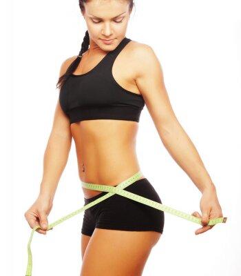 Fototapeta sportowy kobieta patrząc na miarę