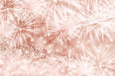 Fototapeta Srebrne i różowe złoto fajerwerki i bokeh na papierze gliter w Nowym Roku i kopiowania. Abstrakcyjne tło wakacje.