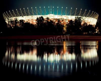 Fototapeta Stadion Narodowy w Warszawie w nocy z odbicia w Wiśle.