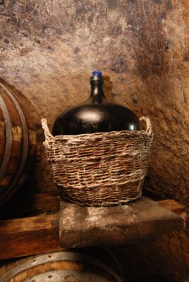 Fototapeta Stare butelki wina w koszu