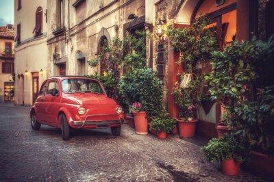 Fototapeta Stare zabytkowe kult samochód zaparkowany na ulicy w restauracji, w