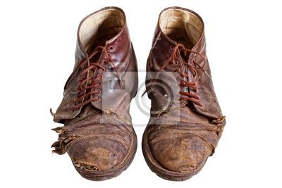 Stare zużyte buty, odizolowane na białym