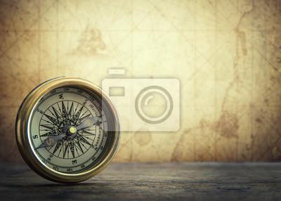 Starego rocznika retro kompas na antycznym mapy tle. Geografia podróży pojęcie tła.