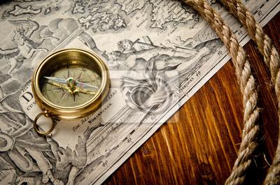 stary kompas i liny na mapie rocznika 1733
