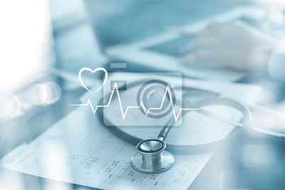 Fototapeta Stethoscope with heart beat report and doctor analyzing checkup on laptop in health medical laboratory background.