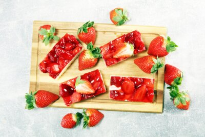 strawberry cake and many fresh strawberries on grey background table