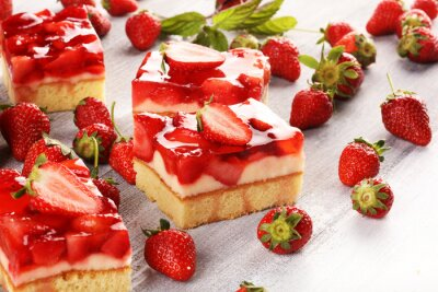 strawberry cake and many fresh strawberries on rustic background table