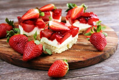 strawberry cake and many fresh strawberries on rustic table