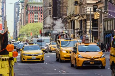 Fototapeta Street view of medallion yellow cabs in Manhattan New York