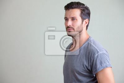 Fototapeta Studio shot of handsome bearded man thinking