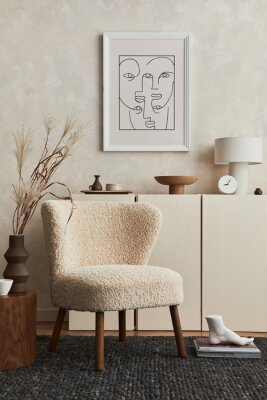 Fototapeta Stylish composition of cozy living room interior design with mock up poster frame, fluffy armchair, coffee table, commode and personal accessories. Modern style. Template.