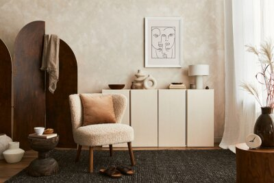 Fototapeta Stylish composition of cozy living room interior design with mock up poster frame, fluffy armchair, folding screen, coffee table, commode and personal accessories. Modern style. Template.