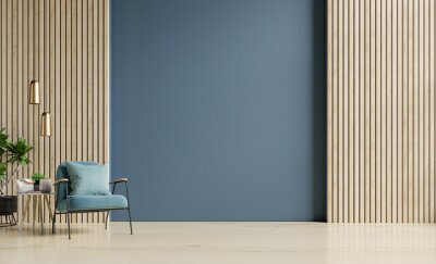 Fototapeta Stylish Modern wooden living room has an armchair on empty dark blue wall background.