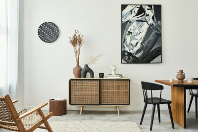 Fototapeta Stylish scandinavian living room interior of modern apartment with wooden commode, design table, chairs, carpet, abstract paintings on the wall and personal accessories in unique home decor. Template.