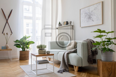 Fototapeta Stylish scandinavian living room with design mint sofa, furnitures, mock up poster map, plants and elegant personal accessories. Modern home decor. Bright and sunny room. Template Ready to use.