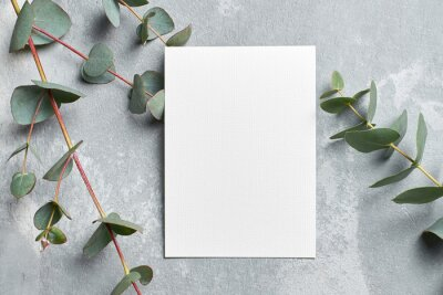 Fototapeta Stylish wedding invitation card mockup with eucalyptus branches on grey stony background