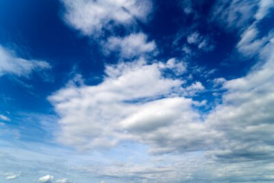 Fototapeta Summer Blue Sky and white cloud white background. Beautiful clear cloudy in sunlight calm season. Panoramic vivid cyan cloudscape in nature environment. Outdoor horizon skyline with spring sunshine.