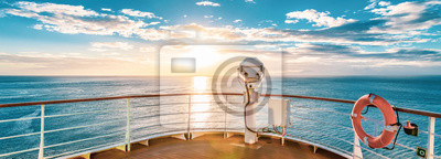 Fototapeta Summer cruise vacation concept. Panoramic view of the sea with a beautiful sunset just above the horizon.