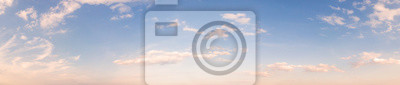 Fototapeta Summer sky background with warm sunny tonings. Wide angle panorama, banner